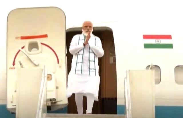 PM Modi lands in Hyderabad, on way to Bharat Biotech.
