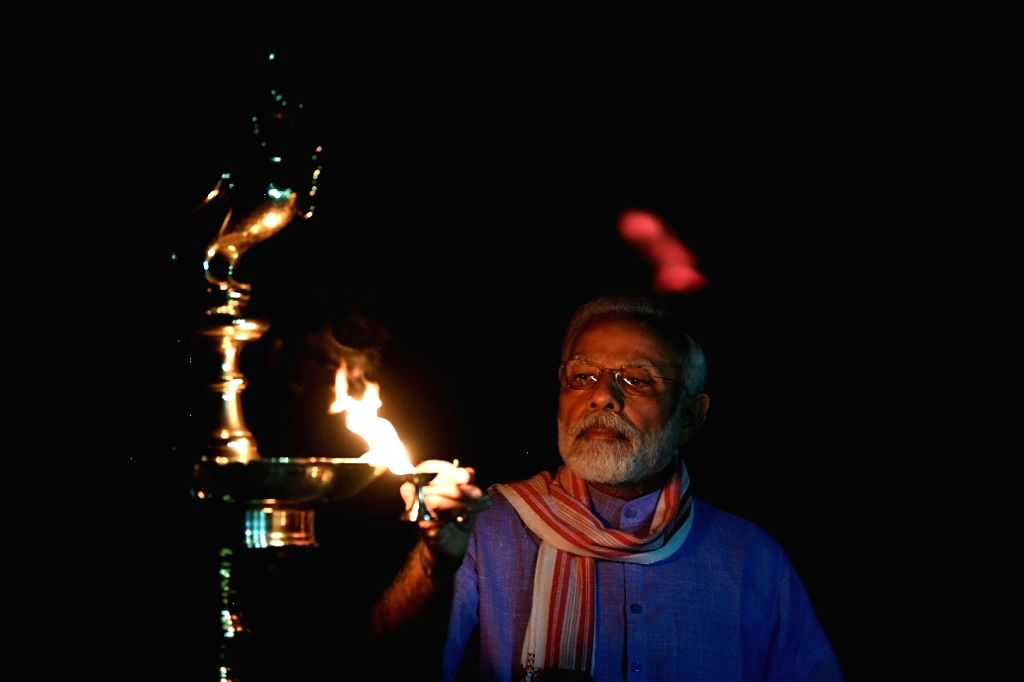 PM Modi lights up lamp at his residence during 9 Baje 9 minutes to show solidarity in fight against coronavirus.
