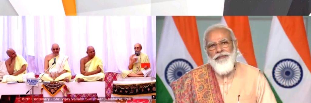 PM Modi unveils statue of Jaincharya Shri Vijay Vallabh.