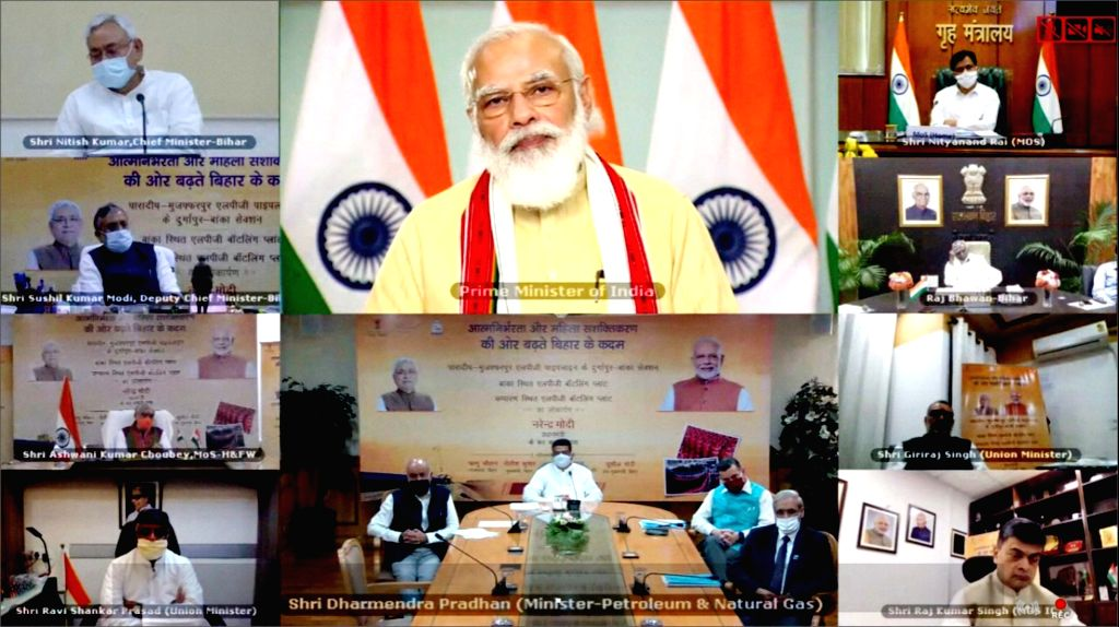 PM Narendra Modi with Chief Minister Nitish Kumar discusses three projects of Ministry of Petroleum & Gas via video conferencing in Patna on September 13, 2020. - Nitish Kumar and Narendra Modi