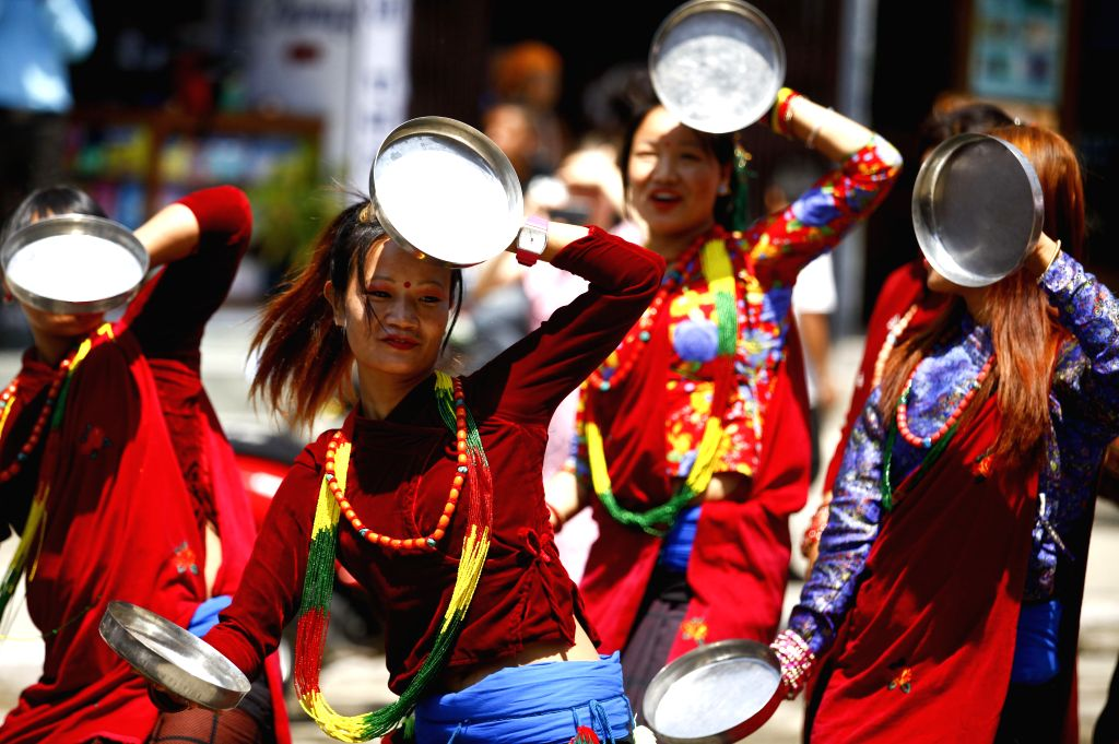 Nepali women dance during the celebration of Fewa New Year Festival in Pokhara city, which is some 200 km west of capital Kathmandu and collect water from the ...
