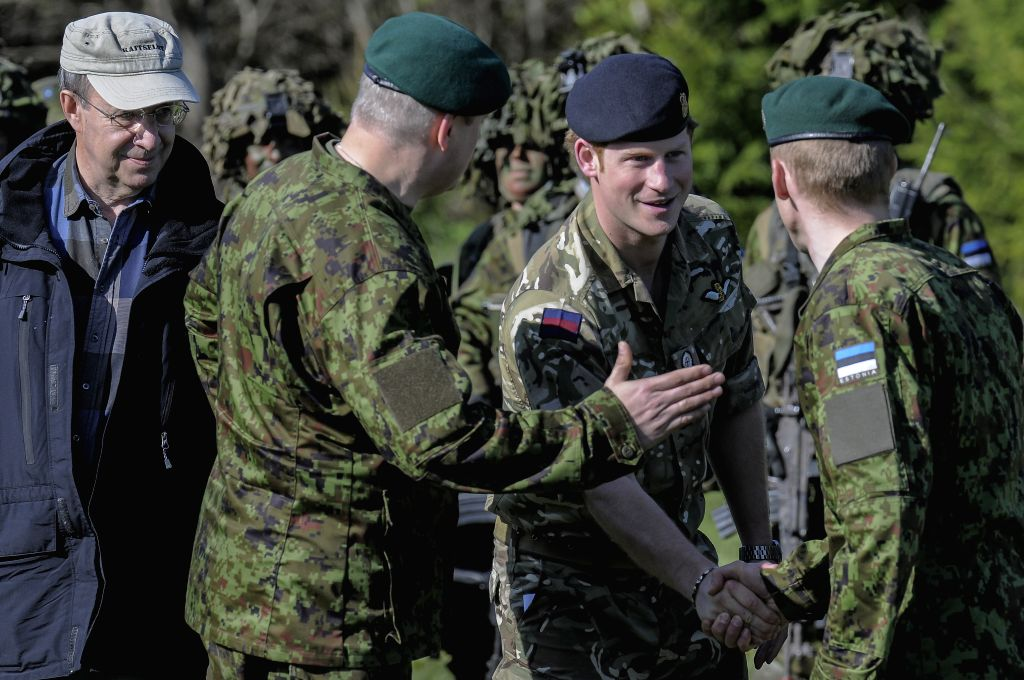 Britain's Prince Harry (2nd R)meets British soldiers on May 17, 2014 during a visit to the Estonian Defence Forces annual pring Stormtraining exercises held near ...