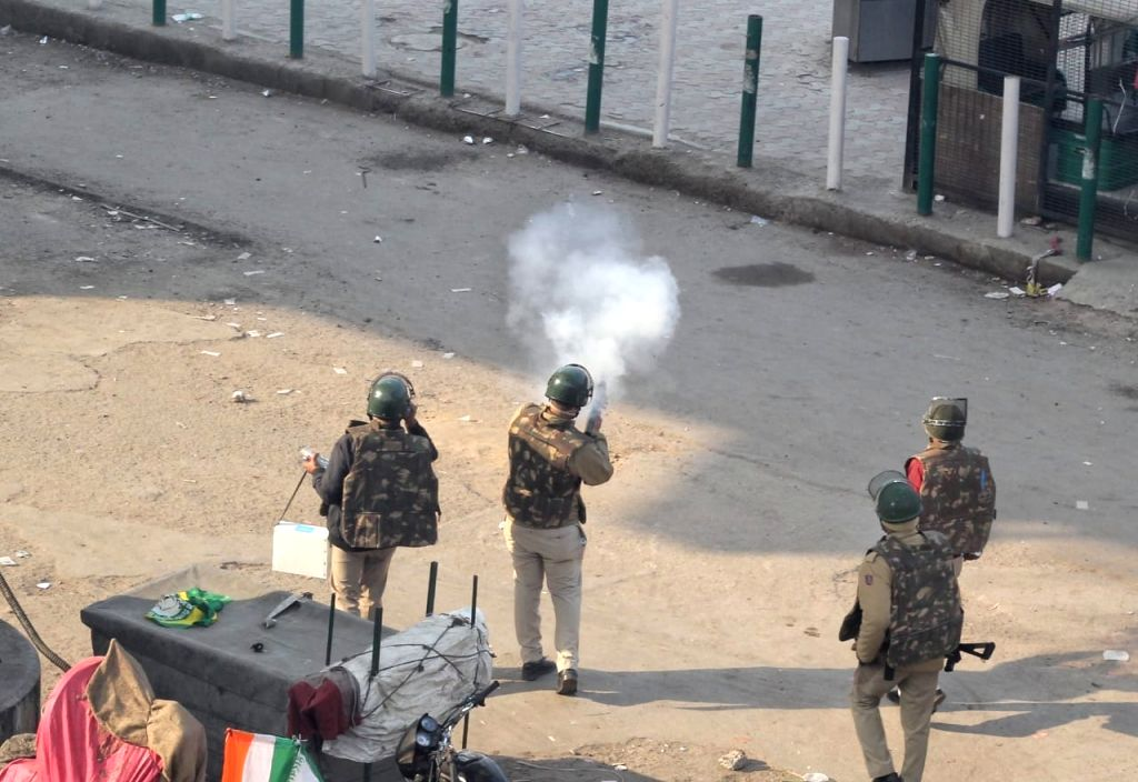 POlice and Farmars clash during the tractor prade march on Republic day during the ongoing protest against new agricultural laws at Tikri border to peeragarhi chowk in new Delhi..