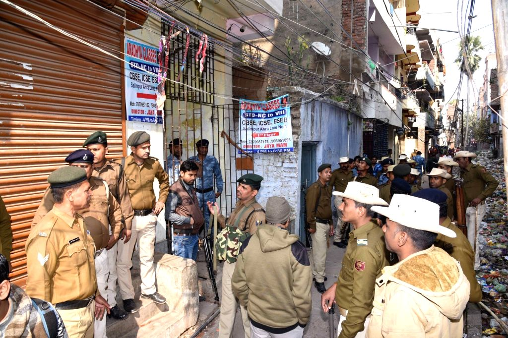 Police and Rapid Action Force (RAF) personnel inspect the site where at least six people were injured in an explosion near Gandhi Maidan area of Patna on Feb 10, 2020. The explosion took place ...