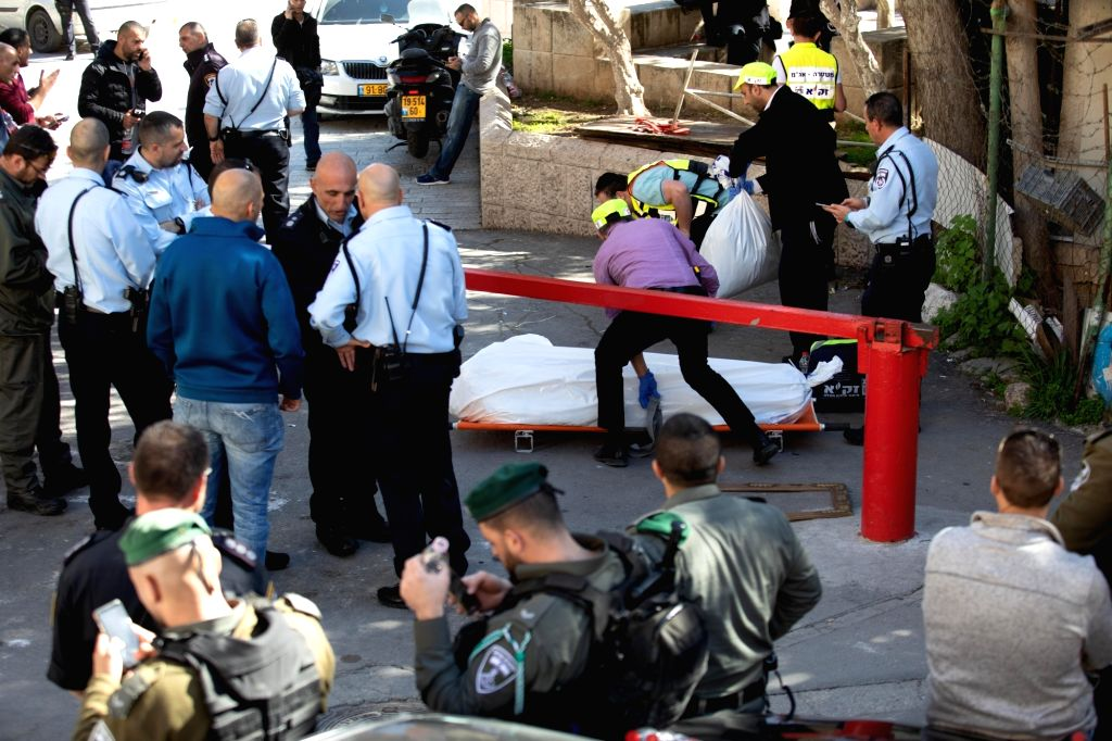 Police are seen at the scene of a shooting attack near Lions Gate in Jerusalem's Old City on Feb. 6, 2020. Israeli border police officers shot dead a Palestinian ...