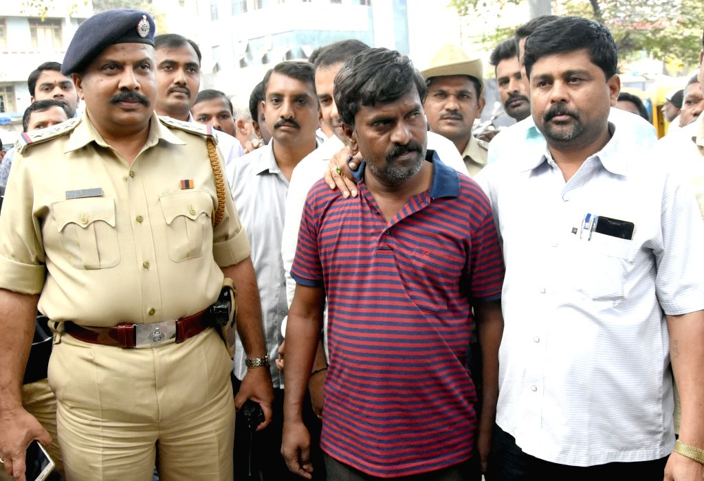 Police arrest Dominic Selvaraj, the driver who decamped with a van that had a cash of Rs. 1.37 crore to be deposited in ATMs on Nov 23; in Bengaluru on Nov 29, 2016.