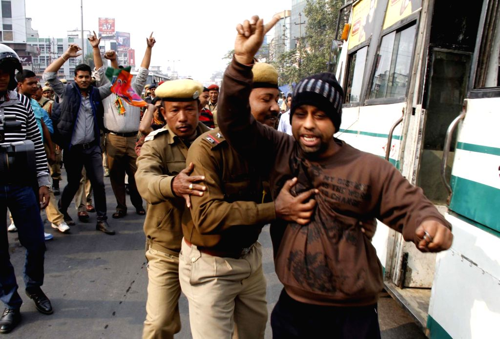 Police arrests BJP workers during 12-hour Assam Bandh called by the BJP to protest against the tabling of Constitutional Amendment Bill in Rajya Sabha, in Guwahati on Dec.20, 2013.