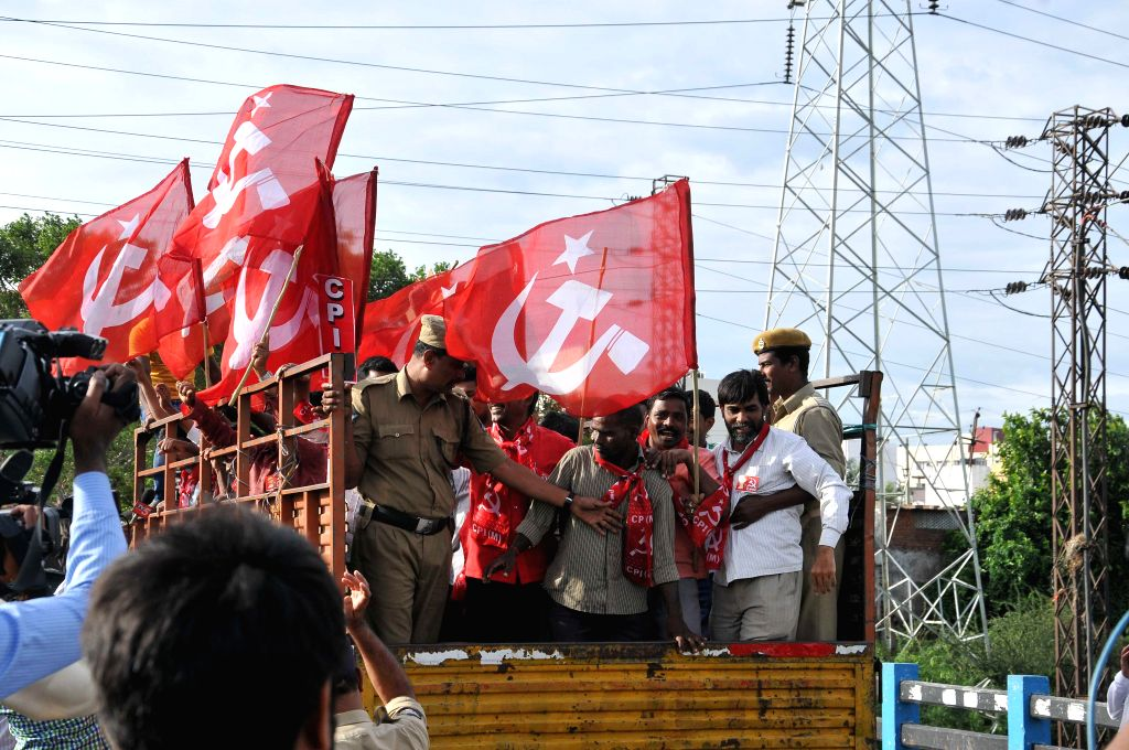 Police arrests the communists demonstrating against passage of Polavaram bill in Lok Sabha for merger of over 200 villages of Telangana with Andhra Pradesh at Hyderabad Bus Depot on July 12, 2014.