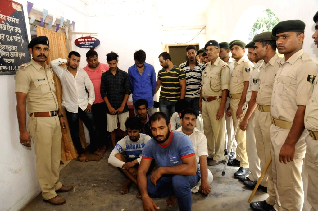 Police arrests youths over spreading violence outside Bihar Chief Minister's residence on Saturday in Patna on Aug 20, 2017.
