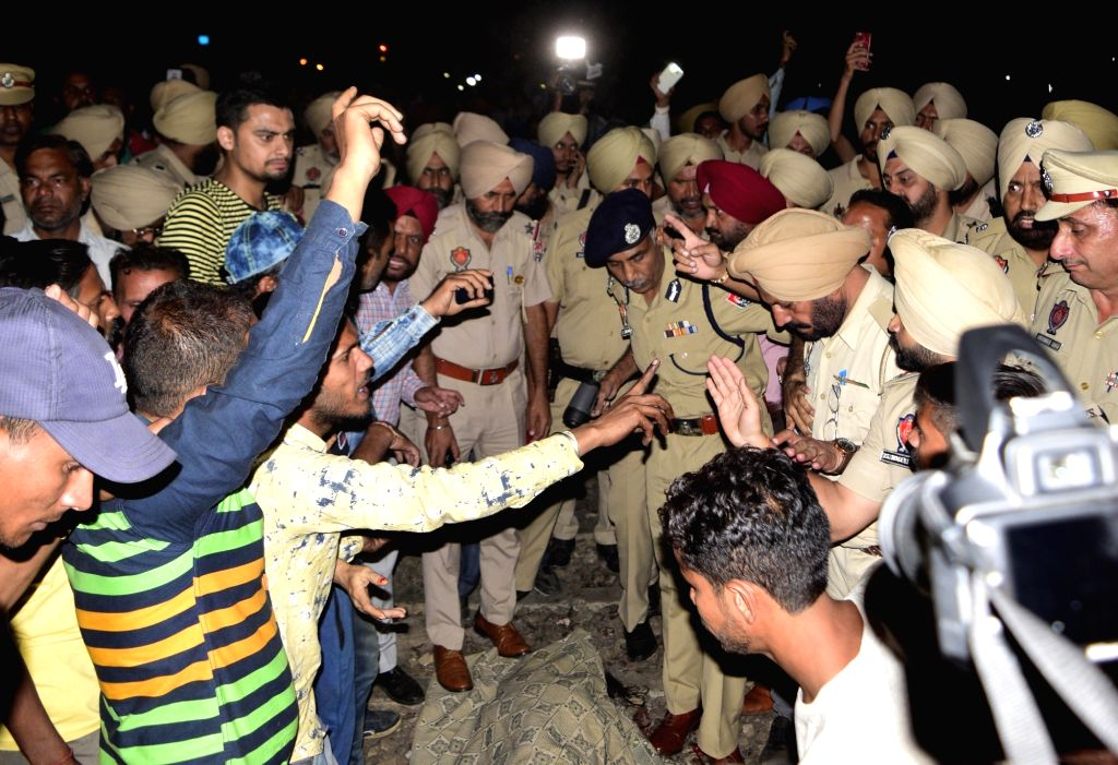 Police at the site where at least 30 people glued to watching a burning Ravan effigy while standing on railway tracks were crushed by a speeding train in Amritsar on Oct 19, 2018.