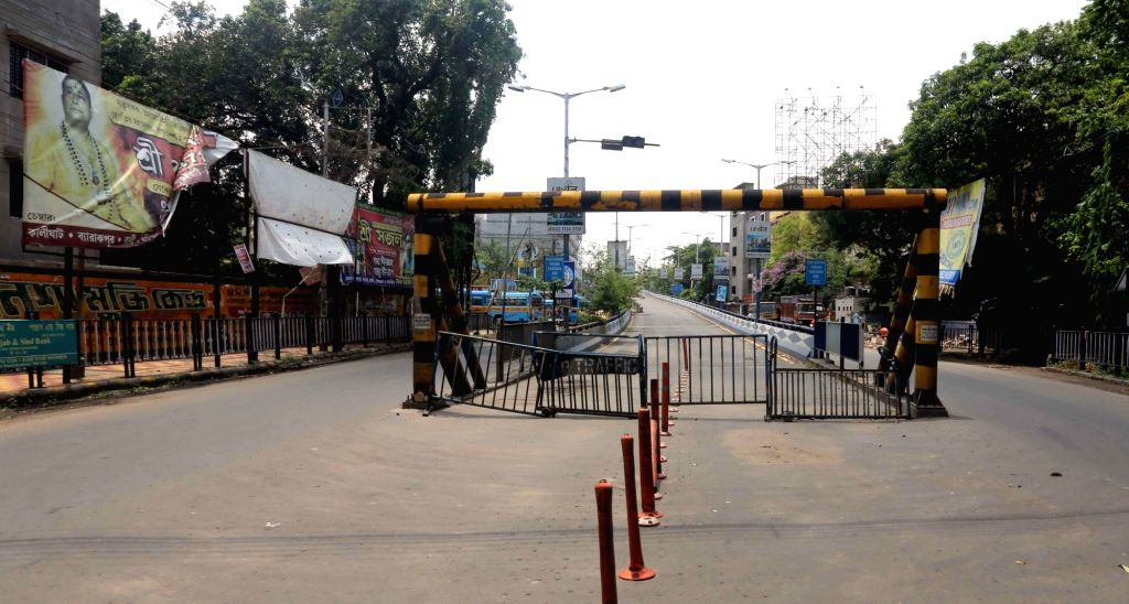 Police barricades put up at a Kolkata road during the extended nationwide lockdown imposed to mitigate the spread of coronavirus; on Apr 24, 2020.