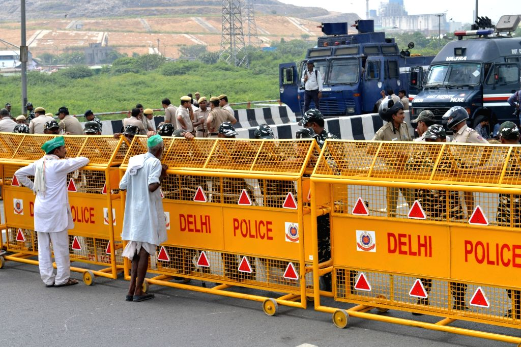 Police barricades put up barricades at the Delhi-UP border near Ghazipur to prevent protesting farmers from reaching the national capital, on Sep 21, 2019. The farmers demand payment of ...