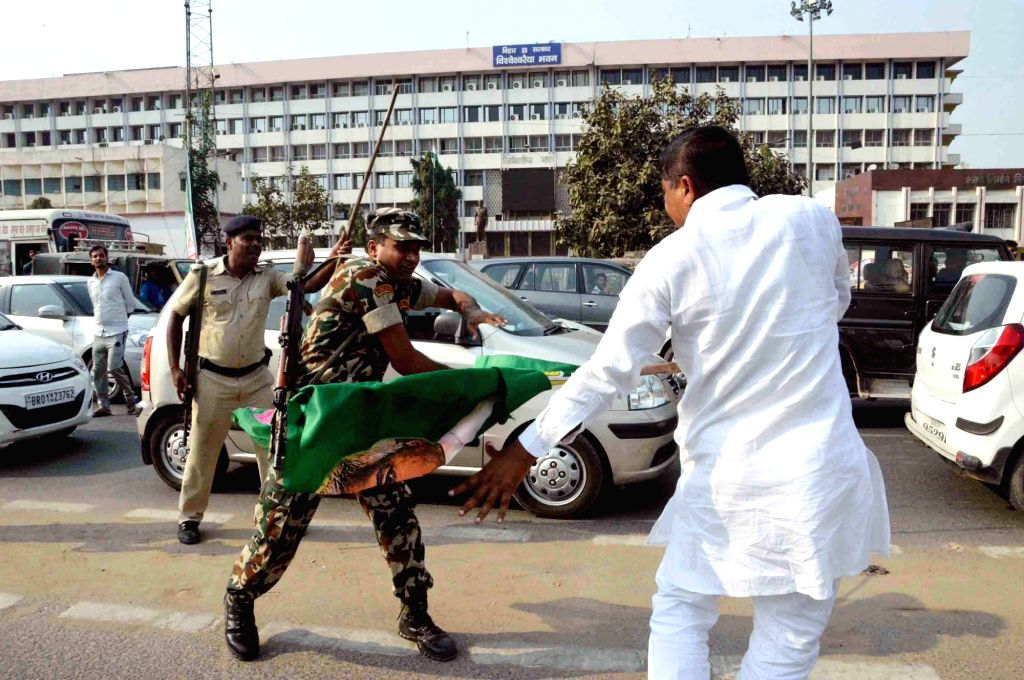 Police baton-charges an RJD worker during the party's protest march to Raj Bhavan against the Central and the State Governments; in Patna on Nov 4, 2018.