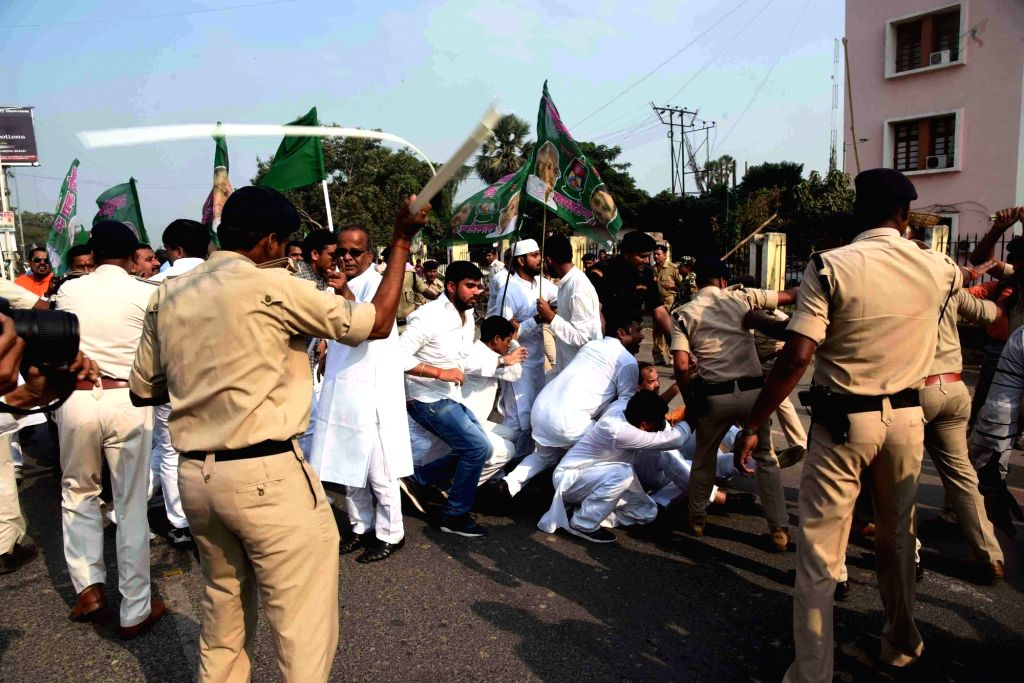 Police baton-charges RJD workers during the party's protest march to Raj Bhavan against the Central and the State Governments; in Patna on Nov 4, 2018.