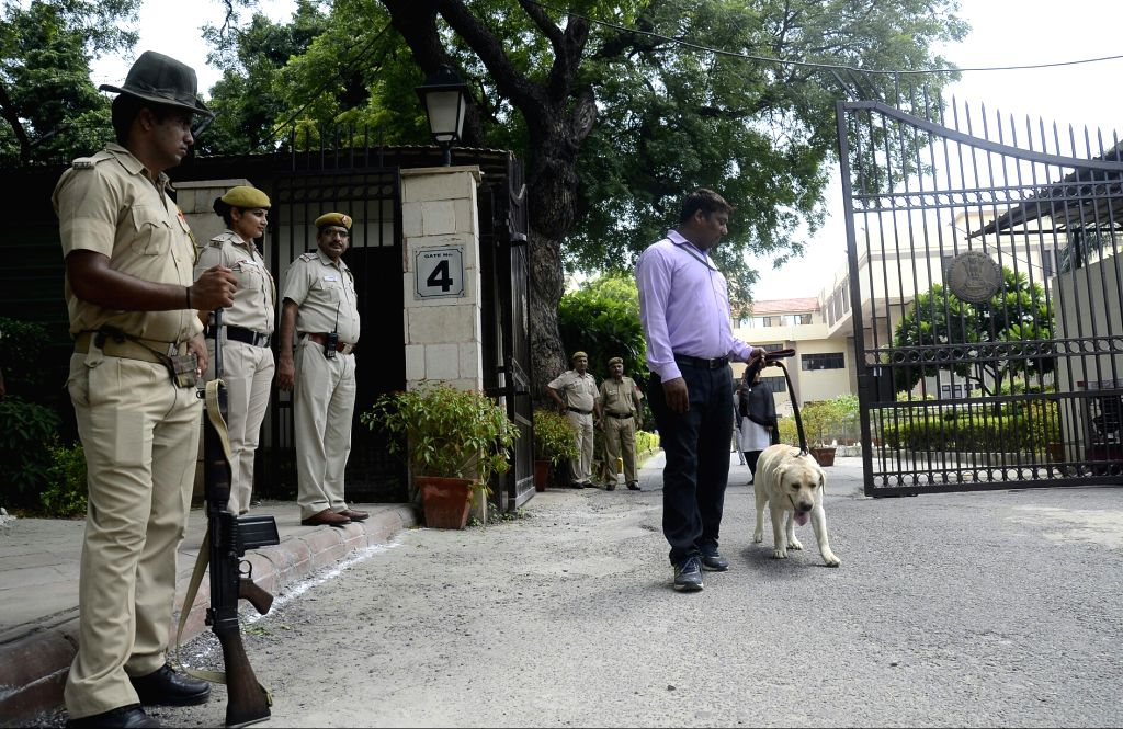Police carries out search operation in the Delhi High Court complex after an anonymous caller warned of a bomb explosion in the premises which turned out to be a hoax, in New Delhi on Aug ...