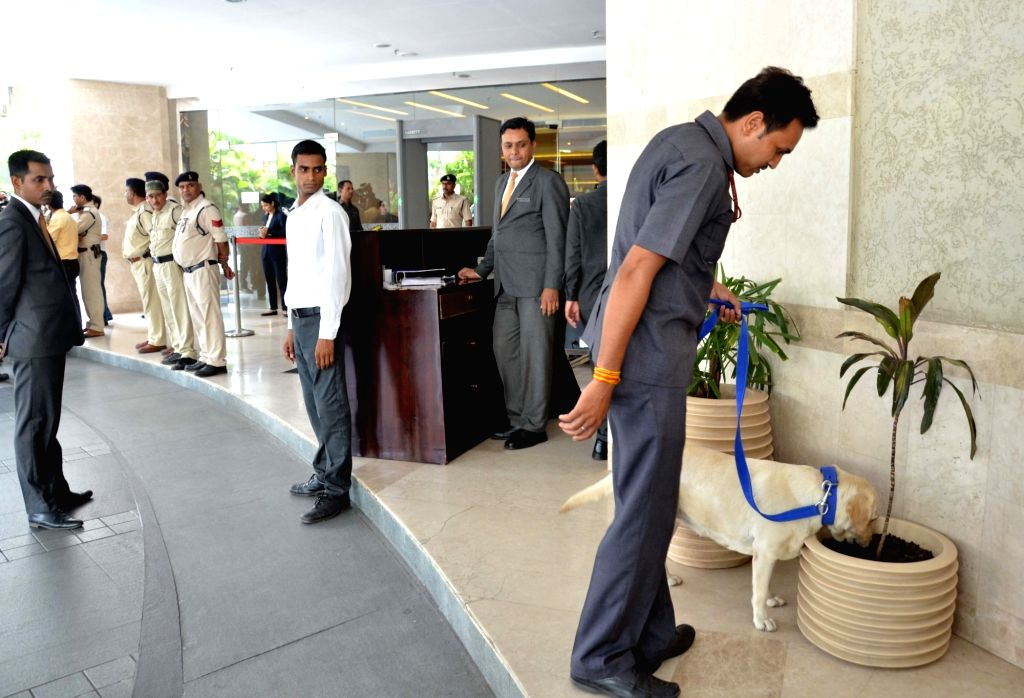 Police carry out search operations at a Bhopal hotel after a bomb hoax on May 30, 2017.