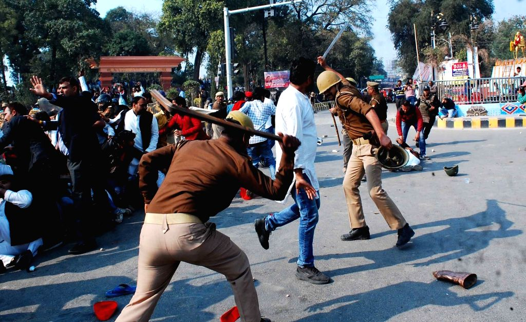 Police charge batons on Samajwadi Party supporters staging a protest after Samajwadi Party chief Akhilesh Yadav was not allowed to take a flight to attend an event in Allahabad University; ... - Akhilesh Yadav