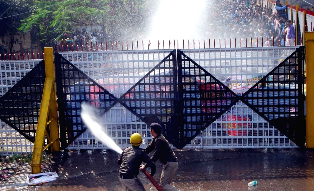 Police charge water cannon on teachers staging a demonstration to press for their various demands in Patna, on Feb 18, 2019.