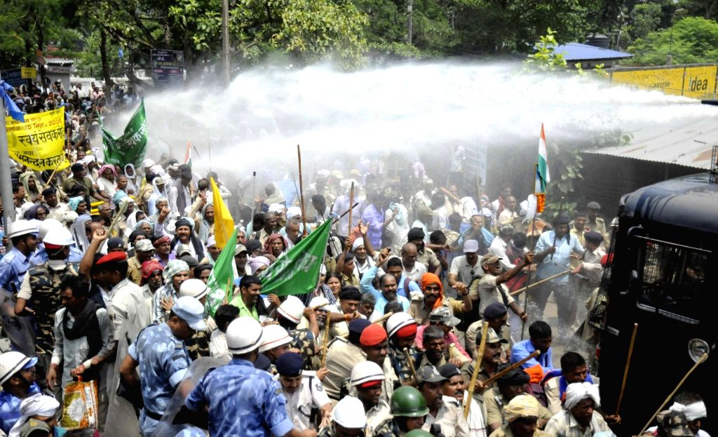 Police charge water cannons on Bihar Home Guard Jawans during a demonstration in Patna on May 15, 2017.