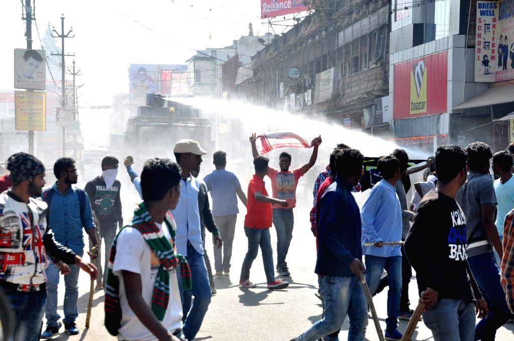 Police charge water cannons on people protesting against Chotanagpur Tenancy (CNT) and Santhal Pargana Tenancy (SPT) Act Amendment Bill 2016 in Ranchi on Nov 25, 2016.