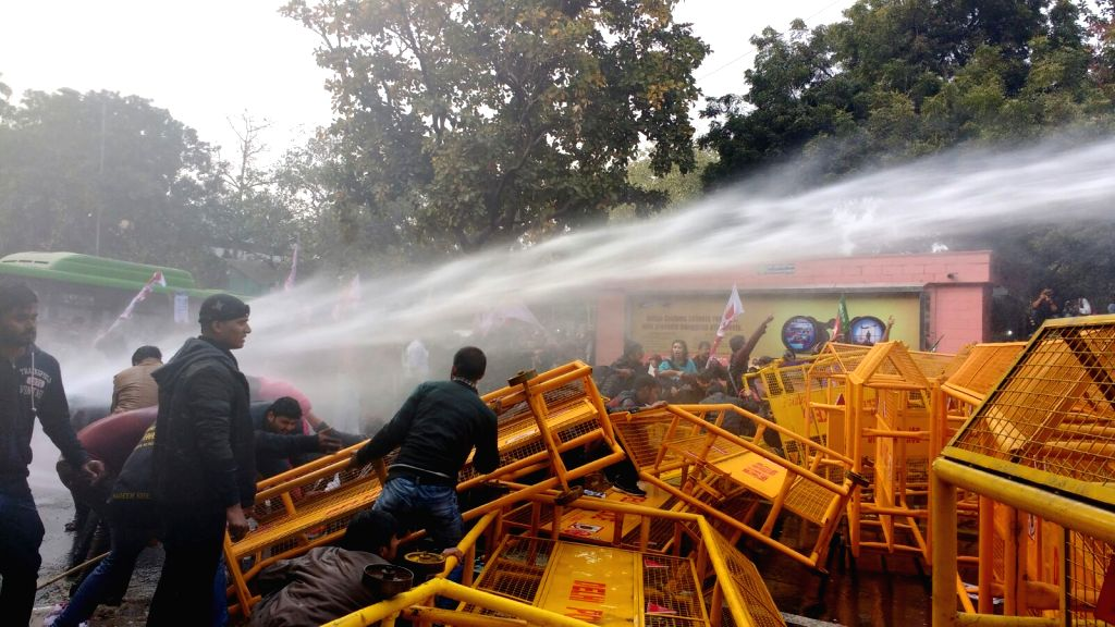 Police charge water cannons on students affiliated to left wing students organisations staging a demonstration to press for their demands in New Delhi on Jan 18, 2016.