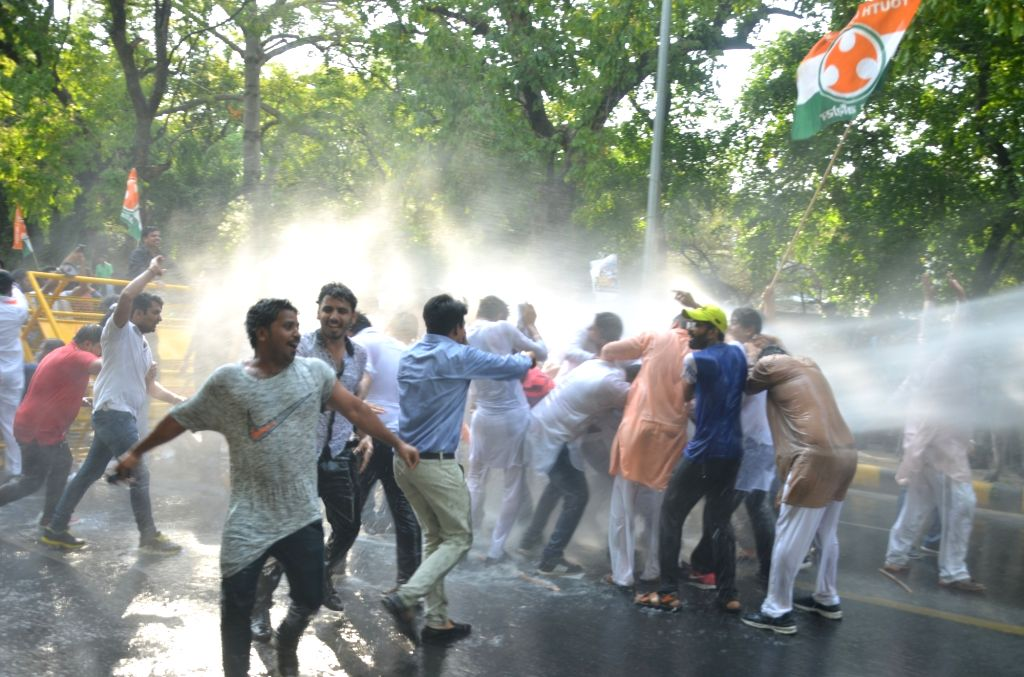 Police charge water cannons on Youth Congress activists staging a demonstration against Union Government in New Delhi on May 26, 2017.