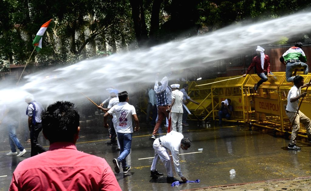 Police charge water canons on people staging a demonstration against Saharanpur violence at Jantar Mantar in New Delhi, on June 11, 2017.