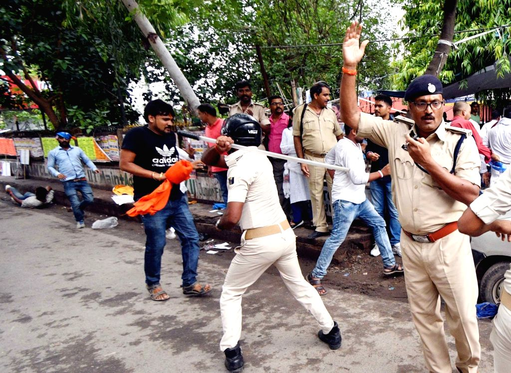 Police charges activists of National Students' Union of India (NSUI) with batons as they stage a demonstration to press for their various demands, in Patna on July 30, 2018.
