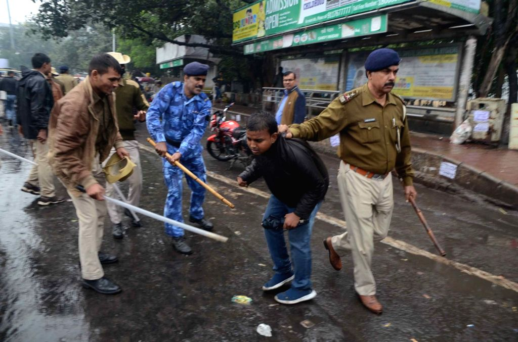 Police charges Patna University students with baton and water canons protesting against the gang rape of a college student, in Patna on Dec 13, 2019.