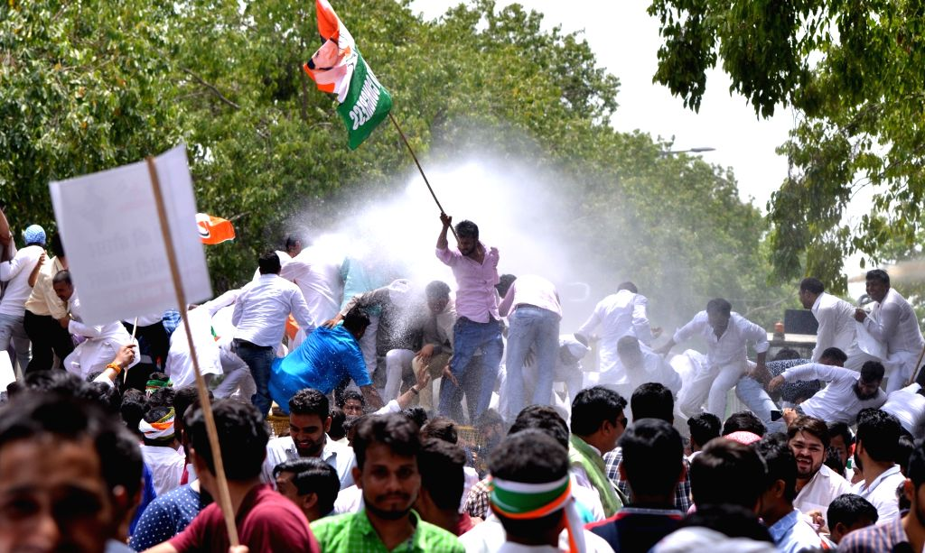 Police charges Youth Congress activists with water canons as they stage a demonstration against Prime Minister Narendra Modi-led Central Government during 'Bharat Bachao Jan Andolan' ... - Narendra Modi