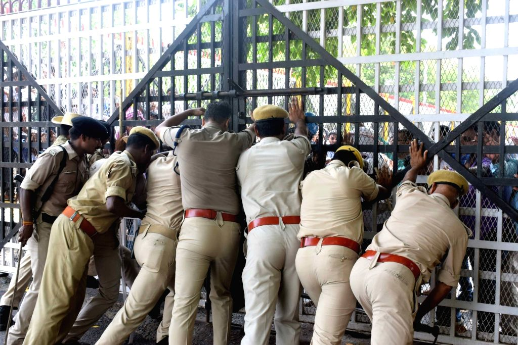 Police contain teachers' protest in Patna on July 18, 2019.