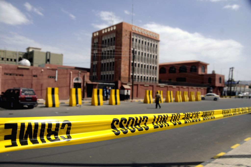 Police cordon off the blast site at the Saba news agency in Sanaa, Yemen, on June 25, 2015. An explosive device went off outside Yemen's state-run Saba news agency ...