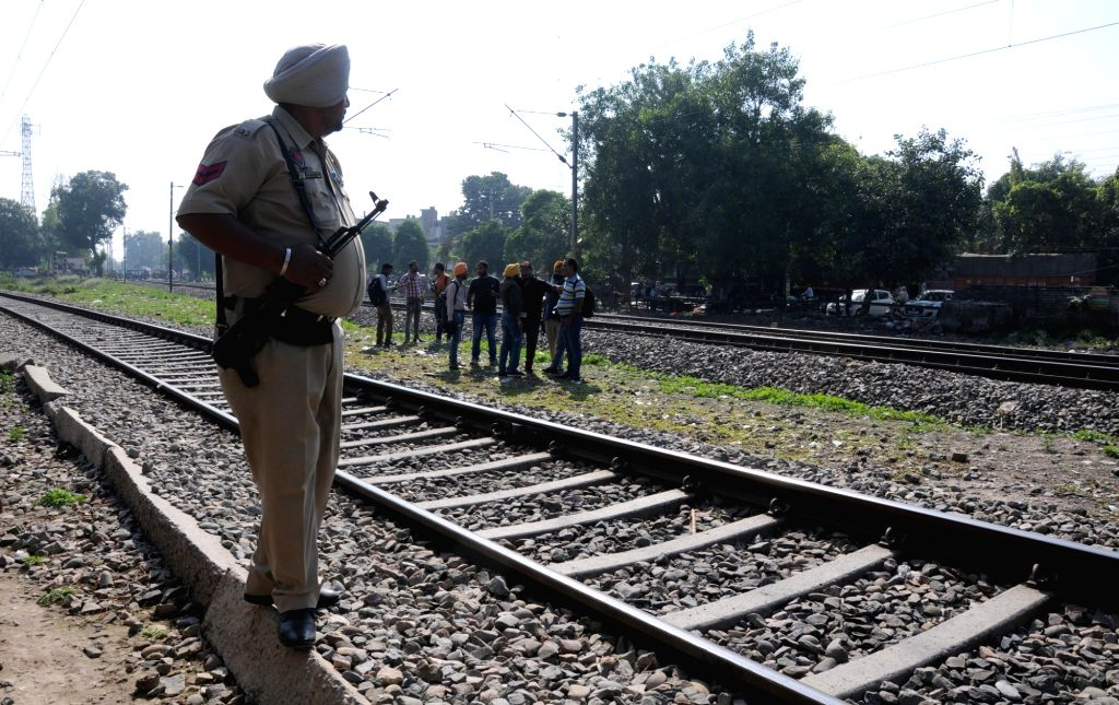 Police deployed at Joda Phatak where family members of the victims of the Amritsar train tragedy where a local train crushed at least 60 people and left 72 injured while watching the ...