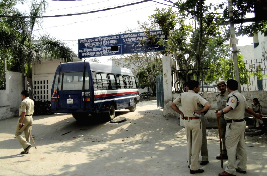 Police deployed outside a North Delhi school where people protested staged a demonstration against a teacher who allegedly molested five students in Jahangirpuri of New Delhi on April 29, 2014.