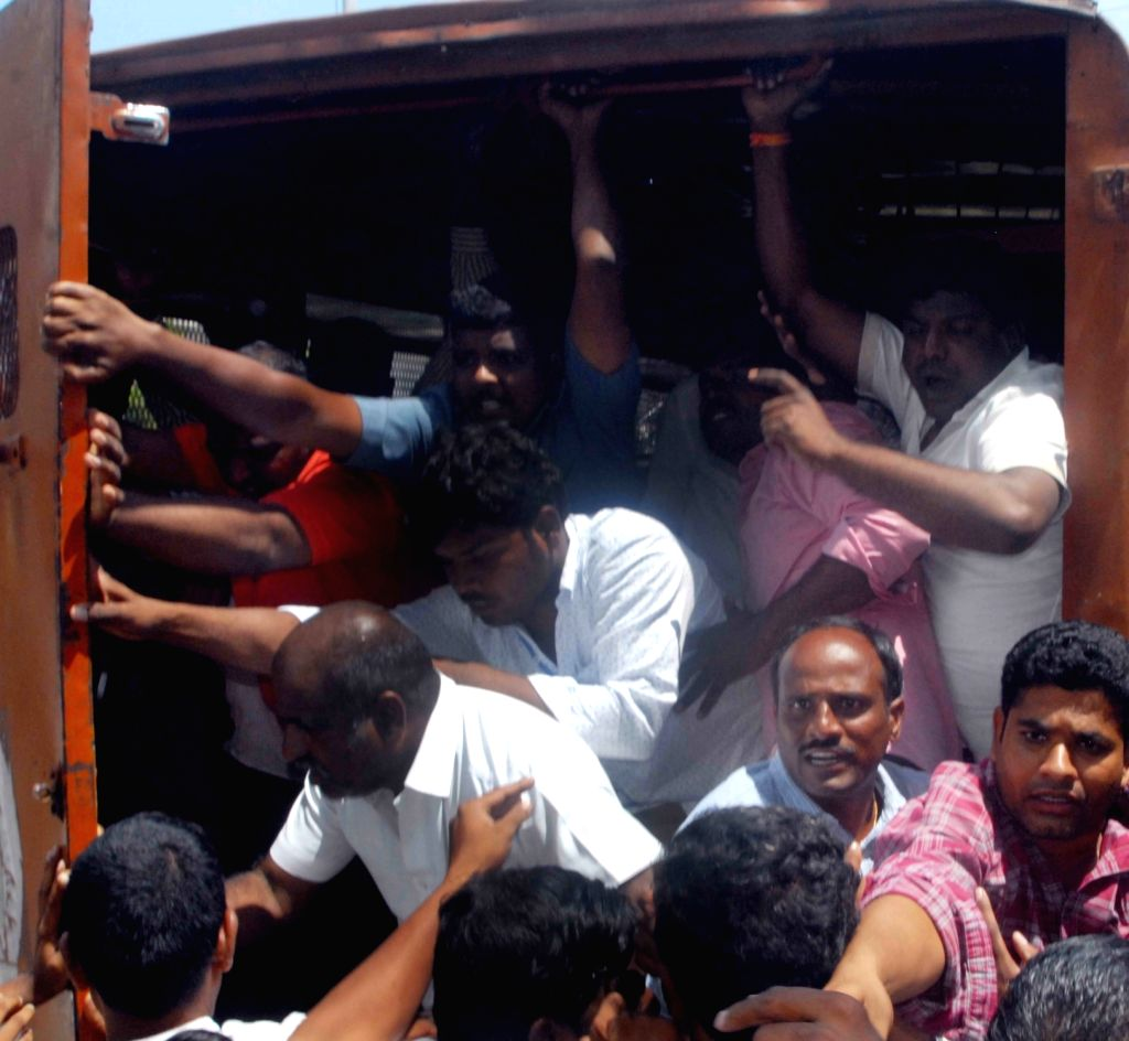 Police detain farmers while they were staging a protest against the state government at Telangana Martyrs Memorial in Hyderabad on Sept 13, 2017.