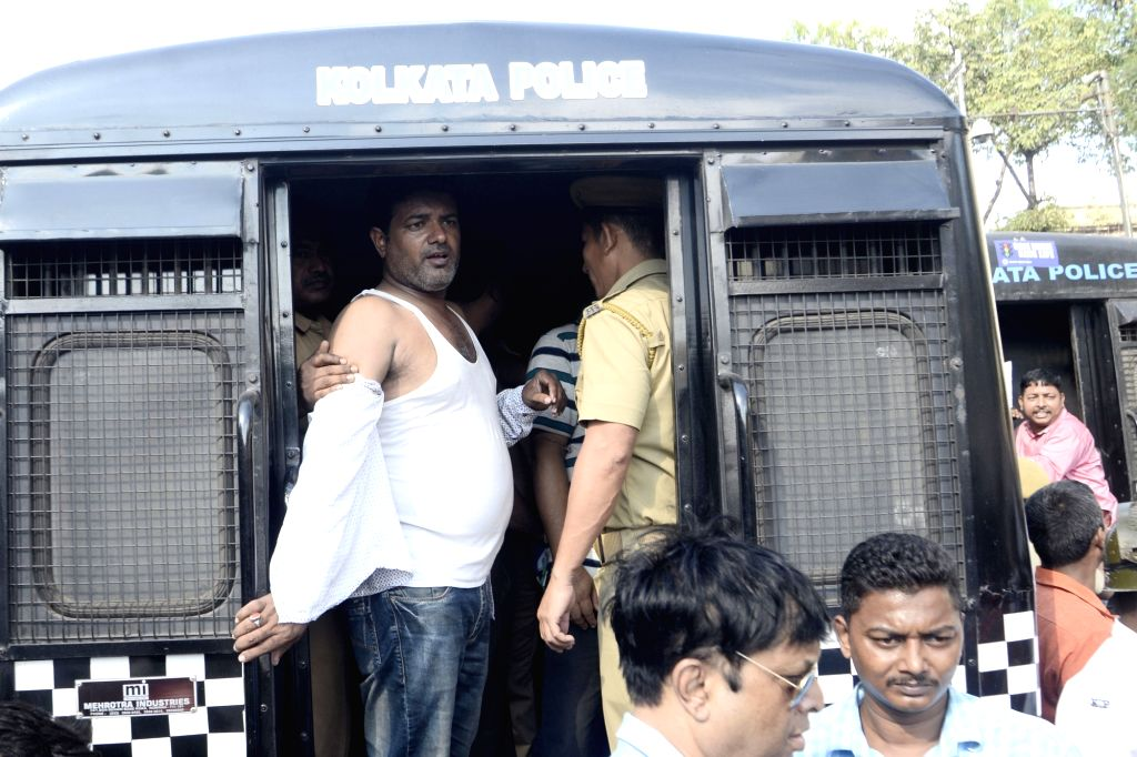 Police detain the members of Joint Council of Bus Syndicate during their rally demanding transport fare price hike due to fuel price hike in Kolkata on Nov. 1, 2018.