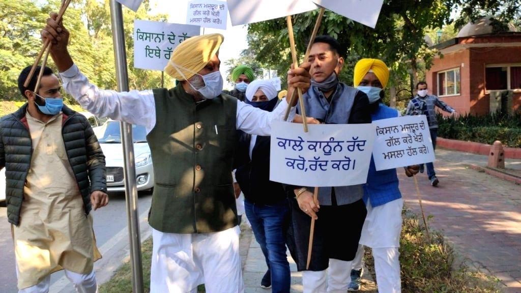 Police detained AAP MLAs while they were shouting slogans and protesting outside the 7, Lok Kalyan Marg official residence of Prime Minister Narendra Modi against the Centre's three Farm ... - Narendra Modi