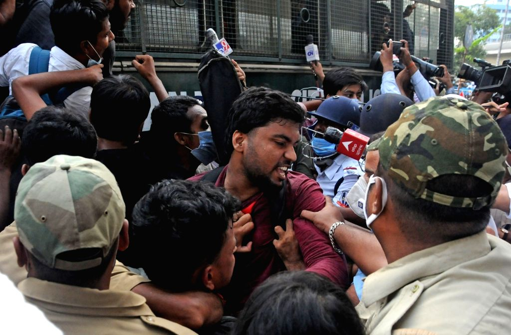 """Police detained Left Students Union activists  during their """"Bikash Bhawan Abhijan""""  for free vaccination for all students and re-open School, college and university at Salt Lake in ..."""