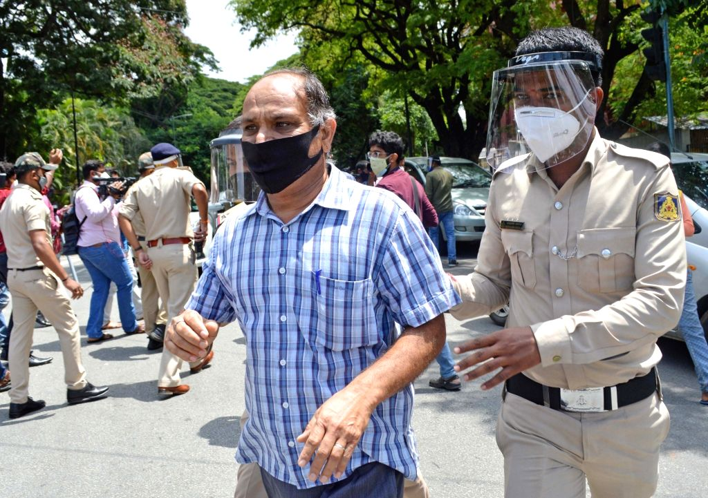 Police detained the public at Hudson circle after their vehicles by the police who were moving around the Bangalore City unnecessarily during Coronavirus lockdown in the wake of the 2nd ...