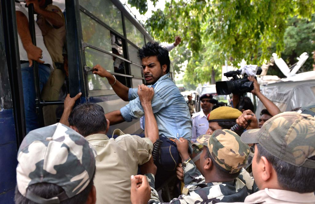 Police detaining National Students` Union of India (NSUI) members during a protest agaist CSAT outside the residence of Home Minister Rajnath Singh New Delhi on August 2, 2014. - Rajnath Singh New Delhi