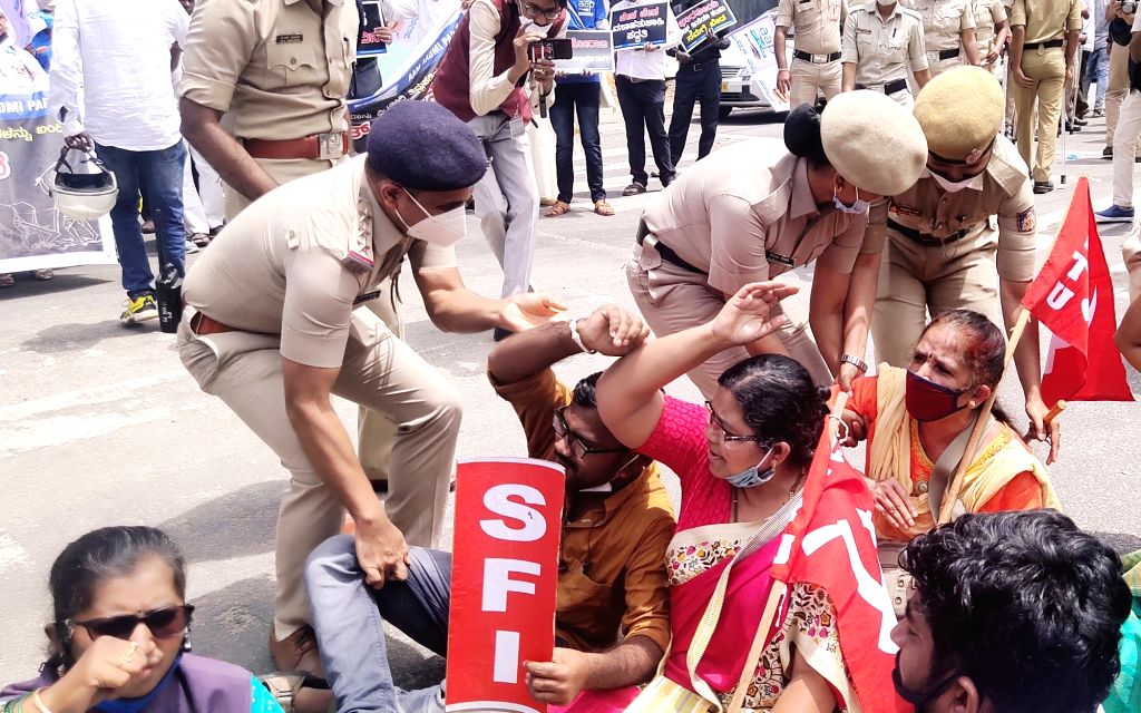 Police detains members of various farmer organisations protesting against the three contentious agriculture-related Bills that have led to agitation by farmers in many states, in Bengaluru ...