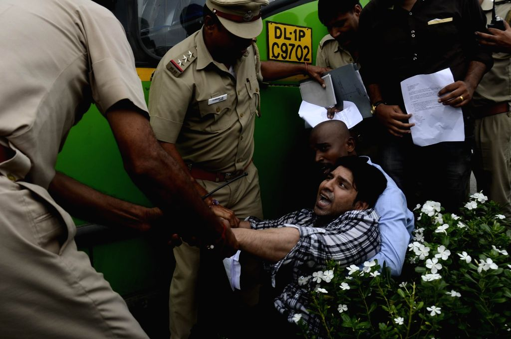 Police detains volunteers of Masuka team protesting against deaths of over 30 children at a Gorakhpur hospital, in New Delhi on Aug 12, 2017.
