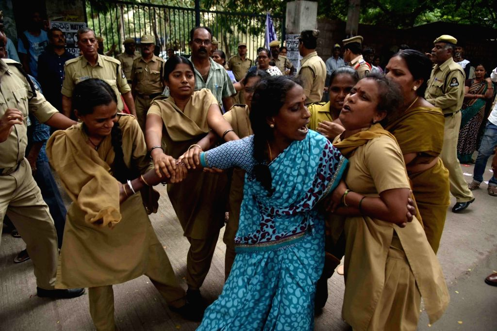 Police detains workers from various sectors while they were protesting to demand minimum wages at the Office of Commissioner of Labour in Hyderabad on Sept 19, 2017.