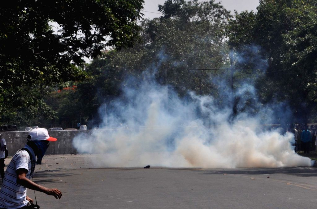 Police fire tear gas shells to disperse protestors after a number of Left Front MLAs including its legislature party leader Sujan Chakraborty were detained from outside the State Secretariat ... - Sujan Chakraborty