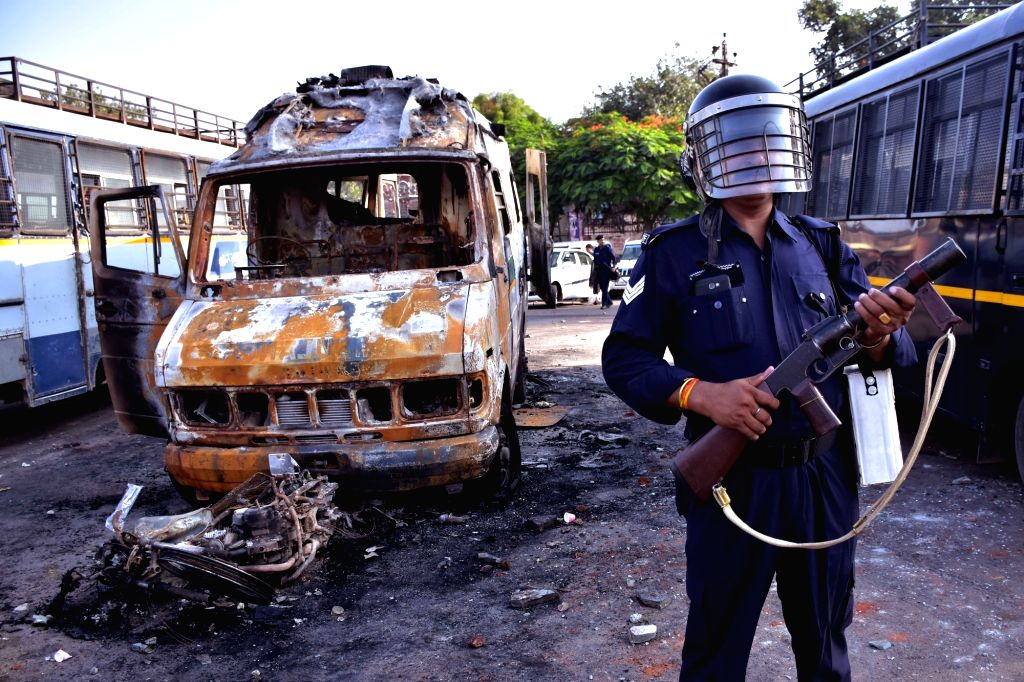 Police guards the streets as curfew was imposed following violence that erupted between locals and the police on the night of Sept 8 after a policeman hit a person sitting on a motor bike ...