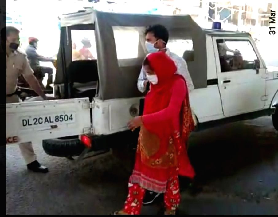 Police helps a pregnant woman during the 21-day countrywide lockdown imposed to contain the spread of coronavirus.