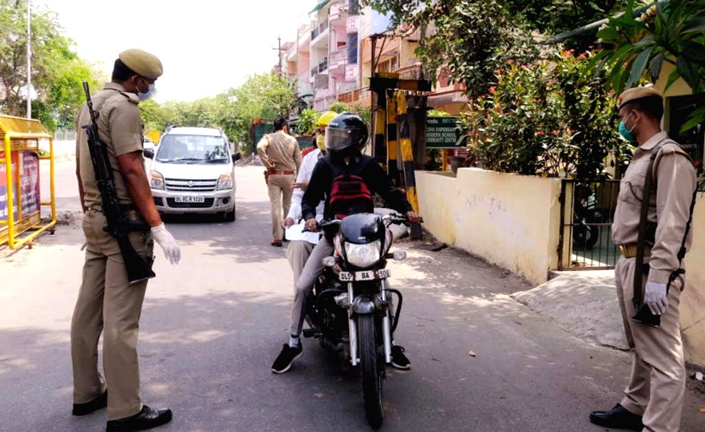 Police intercepts a commuter at the Delhi-Noida Border during the extended nationwide lockdown imposed to mitigate the spread of coronavirus; on Apr 27, 2020.