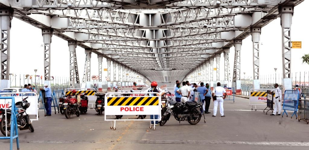Police intercepts commuters at the Howrah Bridge during the biweekly COVID-19 lockdown in Kolkata on Sep 11, 2020.