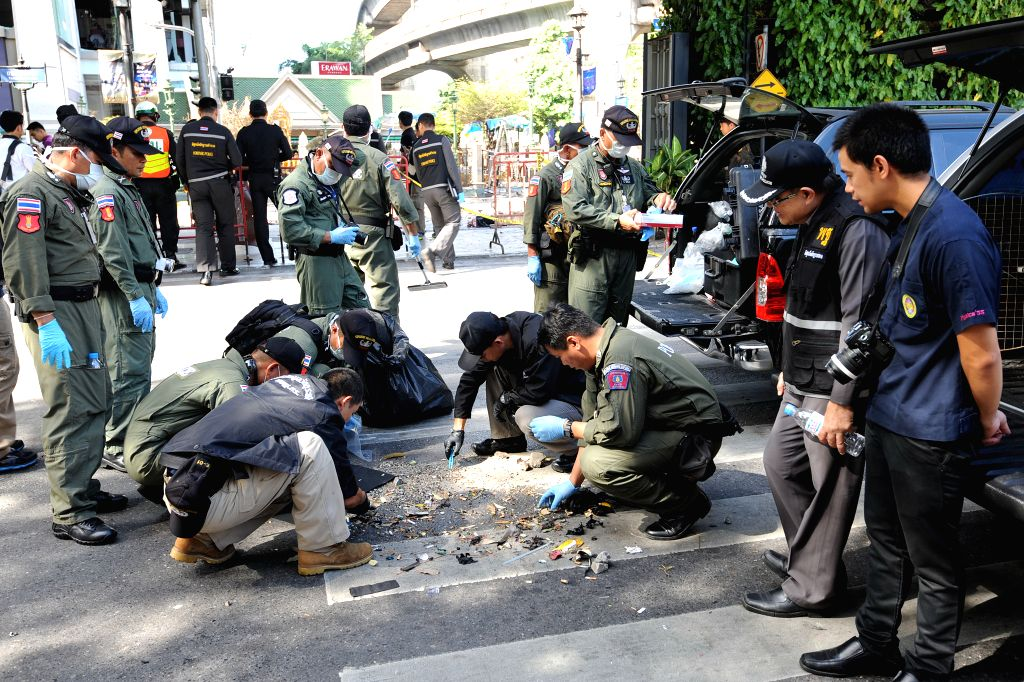 Police investigators work at the explosion site at the Erawan Shrine in Bangkok, Thailand, Aug. 18, 2015. The death toll in the blast Monday night has risen to 20, ...