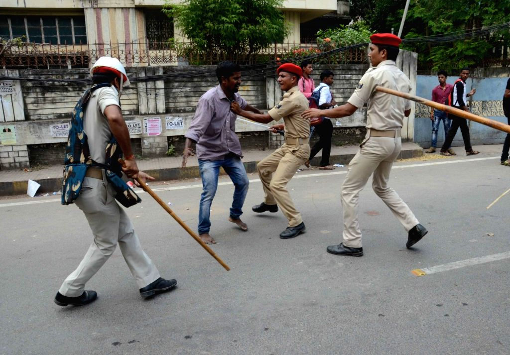 Police lathi charge locals during anti-encroachment drive in Patna on Sept 11, 2017.